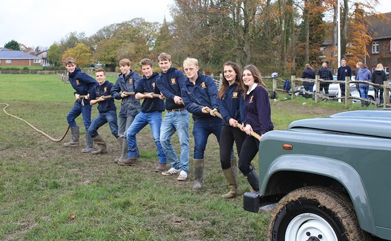 students pulling landrover