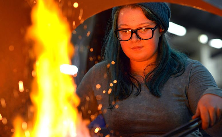 Student by the forge